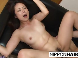 Teenager gets penetrated inside her hairy cunt with a dildo