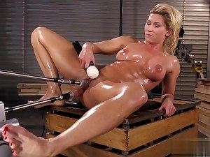 Hot bitch covered in oil masturbates with a huge dildo